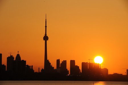 building cn tower: Modern building and CN Tower in downtown Toronto as silhouette
