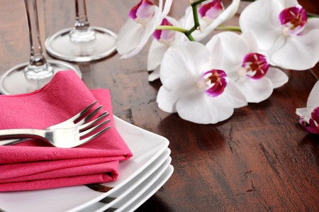 Table set for dinner with glass and flowers Stock Photo - 7446375