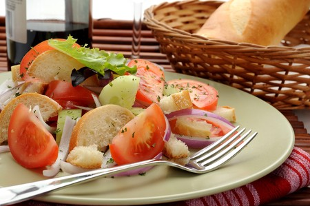 Extreme close-up image of salad and wine and bread in background Stock Photo - 7446379