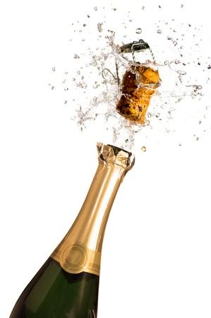 brindisi champagne: Close-up di esplosione della bottiglia di champagne cork