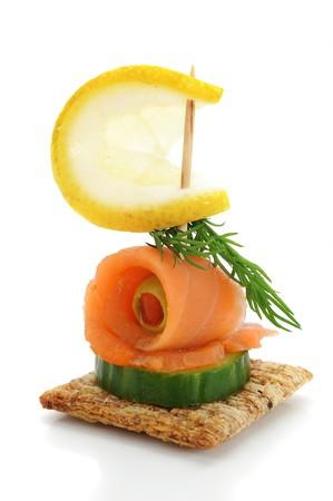 salmon ahumado: Close-up of snack de salmón ahumado, estudio aislado sobre fondo blanco  Foto de archivo