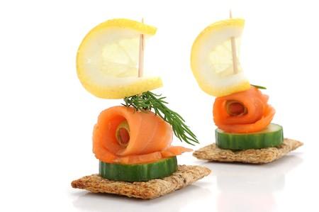 Close-up of smoked salmon snack, studio isolated on white background Stock Photo - 8029101
