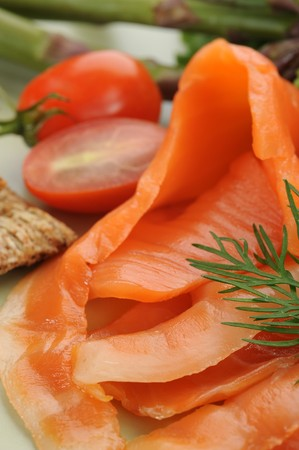 Close-up image of smoked salmon served with tomato photo