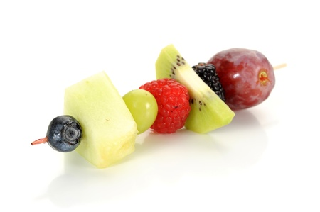 Close-up image of a fruits on a stick studio isolated on white background photo
