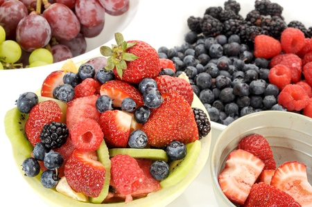 Close-up image of a fruit salad with more fruit around photo