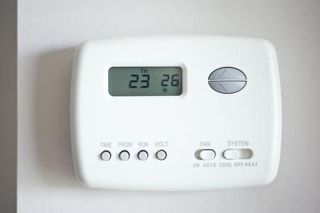 celsius: Digital Thermostat set to 26 degrees Celsius.