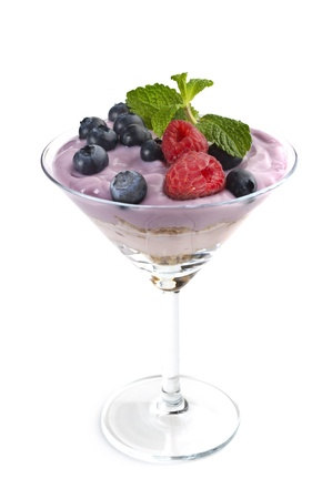 Extreme close-up image of fruit yogurt and cereal on white background photo