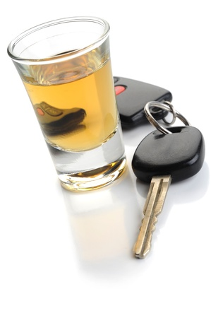 Don't drink and drive - glass of liquor and car keys on white photo