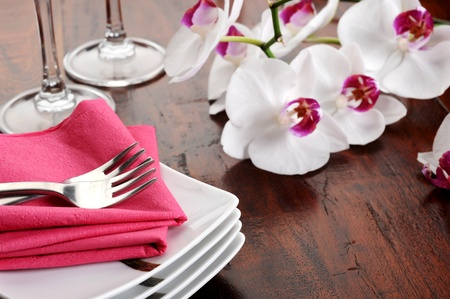 Table set for dinner with glass and flowers Stock Photo - 12274934