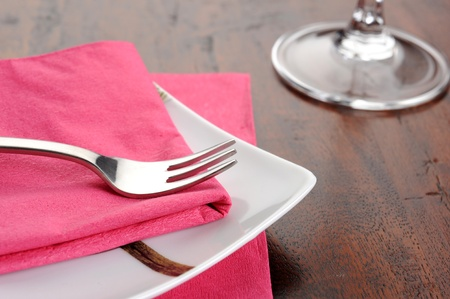 Table set for dinner with glass and flowers Stock Photo - 12274924