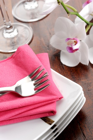Table set for dinner with glass and flowers Stock Photo - 12275099