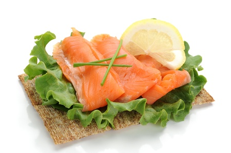 fish meat: Close-up of smoked salmon served with lemon and salad