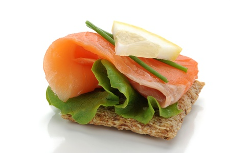 Extreme close-up of smoked salmon served with lemon and salad photo