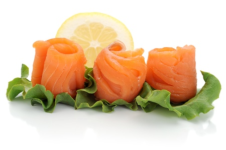 Close-up of smoked salmon served with lemon and salad photo