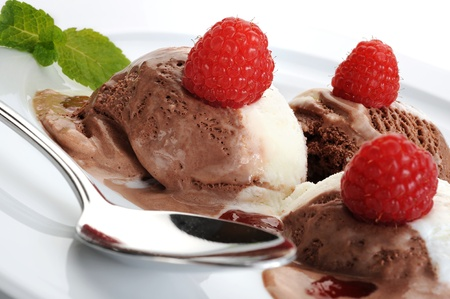 Extreme close-up image of ice cream served with raspberries Stock Photo - 12928088