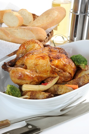 Close-up image of a roasted chicken in a dish with veggies Stock Photo - 13257970