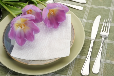 Table set for dinner with glass and flowers Stock Photo - 14185829