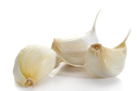 Extreme close-up image of garlic studio isolated on white background