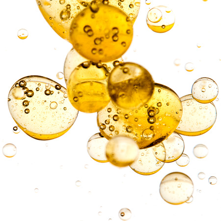 Close up of golden bubbles on illuminated background photo