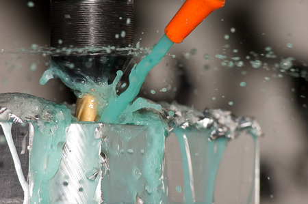 coolant: Milling machine making part while coolant is spraying