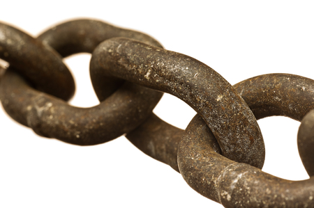chain links: Close-up image of rusty, heavy chain isolated on a white background