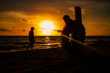 wave tourist: Sunset image with some silhouettes Stock Photo