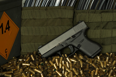 glock: Empty bullets, gun and box with old ammunition