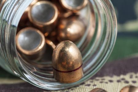 khaki: bullets on camouflage background spill out of the banks on camouflage background