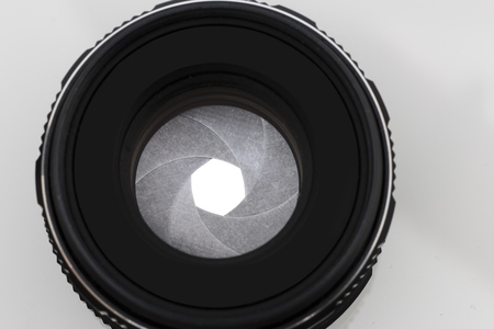 Camera photo lens over white background