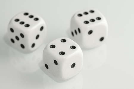 Three white dice isolated on