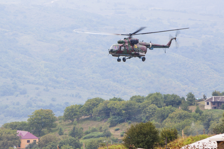 Military helicopter in the air Stock Photo