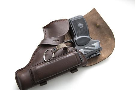 Handgun in a holster on a white background