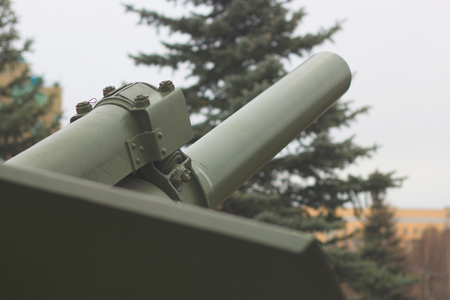 Cannon barrel of powerful with sky on background, modern army artillery, military industry Stock Photo