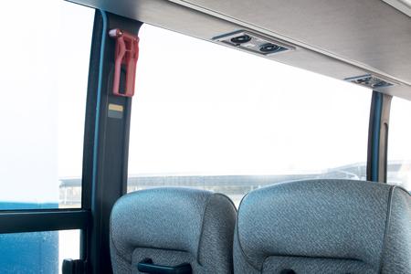 gray empty seats of a large passenger bus