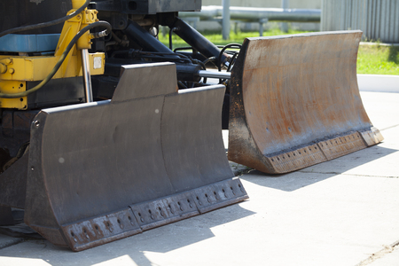 Bulldozer standing on road construction - industrial concept