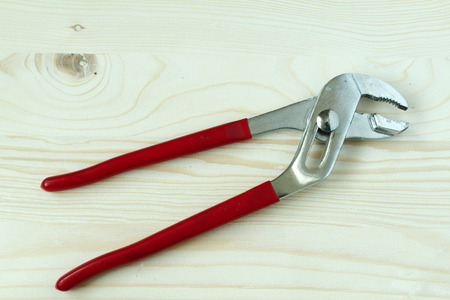 An adjustable wrench