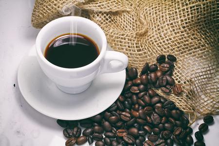 stimulating: black coffee beans on white background