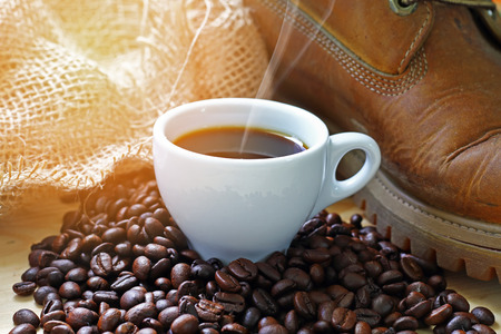 stimulating: coffee background and boot and sacks of coffee bean