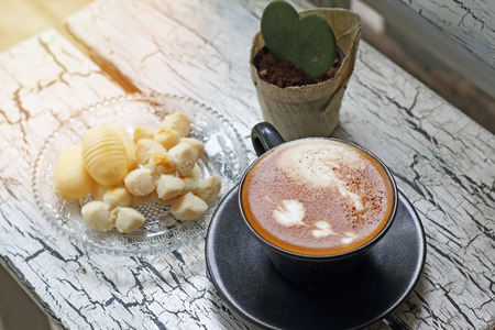 stimulating: Coffee cup of cappuccino and Thai cookie Stock Photo