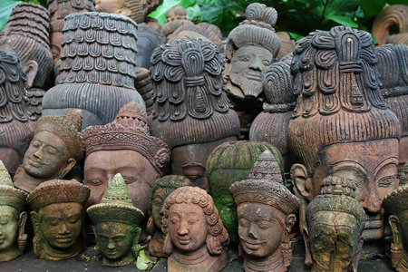 terracotta: close up old terracotta Buddha heads Stock Photo