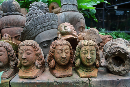 close up old terracotta Buddha heads Stock Photo