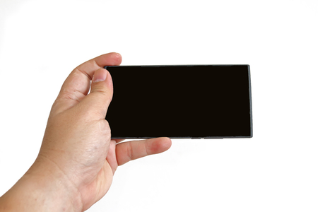 tablet pc in hand: Hand holding smart phone isolated on white background Stock Photo