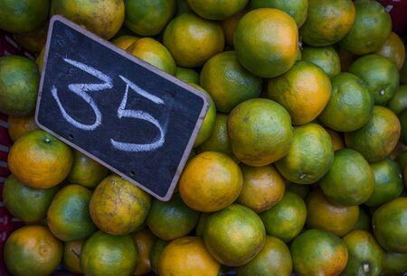 Big fresh oranges in the vegetable market
