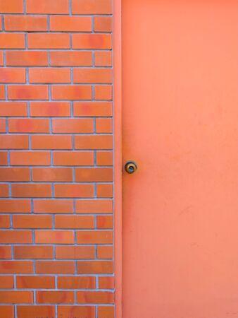 Light red door with red wall Foto de archivo