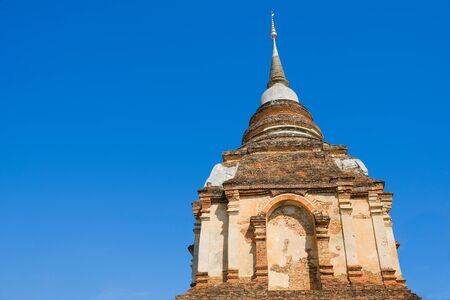 The remains of the ancient pagoda and the bright blue sky.