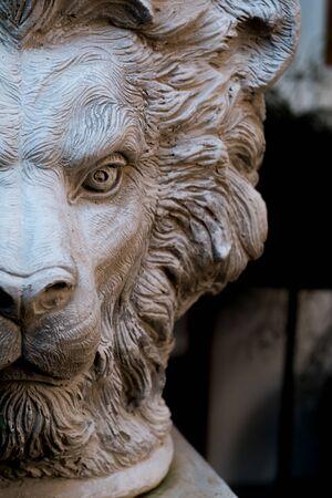 A half-face sculpture of a beautiful lion adorns the house.