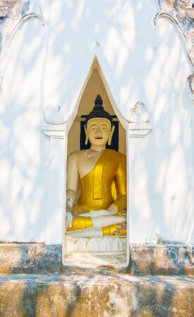 The amulet is inside a white pagoda.