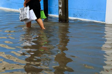 BANGKOK - May 25: A people evacuates from the flooded area at Bangsue district on May 25, 2017  in Bangkok. Editorial