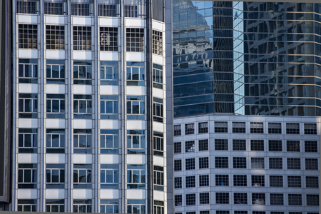 Modern architecture close up with mirror window reflection. Bangkok Thailand 写真素材