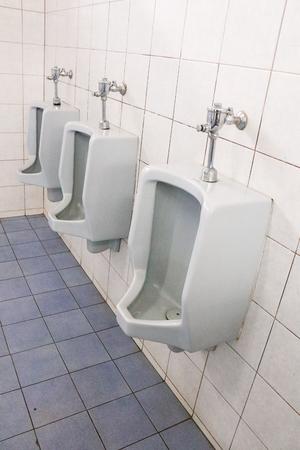 mens bathroom, design of white ceramic urinals for men Banco de Imagens